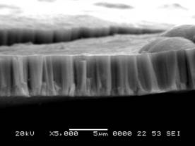 Yttria-stabilized zirconia coating showing columnar microstructure (left) and coating conforming to substrate edge (right)