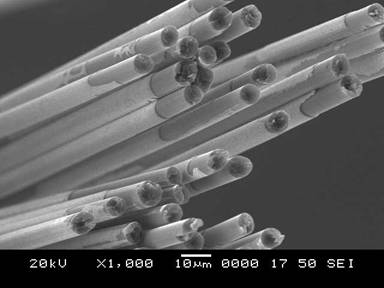 SEM image showing hafnium nitride interface coating on carbon fibers